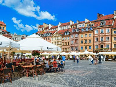 Warsaw, Poland - July 30, 2018: People at sidewalk cafes on Old Town Market Place in Warsaw in Poland